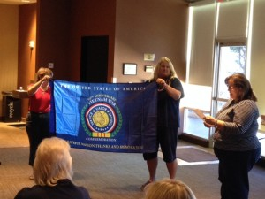 (L  to R): Mary Thurston, Mary Woolford, & Carol Gilmore present the Vietnam War 50th Flag to the chapter.