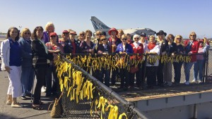 Daughters from District XIV joined District Director Jeanette Shiel and Celebrate America! State Chair Jennifer Smith in a ribbon tying ceremony on the flight deck of the USS Midway to honor the 58,220 Americans who lost their lives in the Vietnam War.