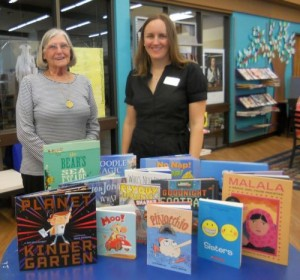 Feather river Chapter Librarian Charlene Peery presents donated books to Sarah Vantrease (on the right), Librarian for the Butte County Library in Oroville